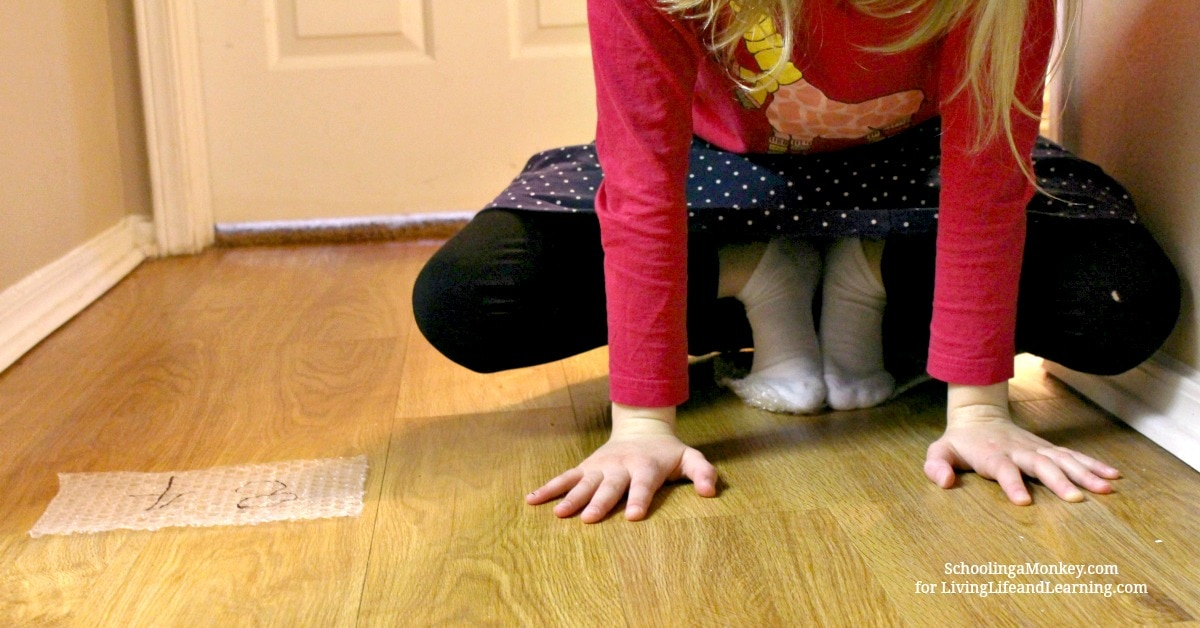 Looking for hands-on math activities? This activity for math fact hopscotch combines gross motor play with math using bubble wrap.
