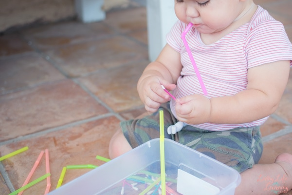Quick and simple engaging toddler boredom buster: Toddler Play with Straws and Cotton Swabs! Great little sensory activity that's quick to set up and even quicker to clean up.