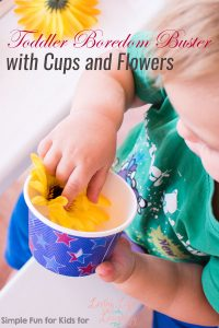 Set up a quick invitation to play to keep your toddler busy: My son had a lot of fun with this Toddler Boredom Buster with Cups and Flowers!