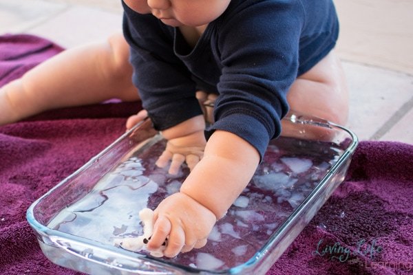 Babies love simple sensory play! Baby play with gelatin and water was loads of fun for my son and not very messy!