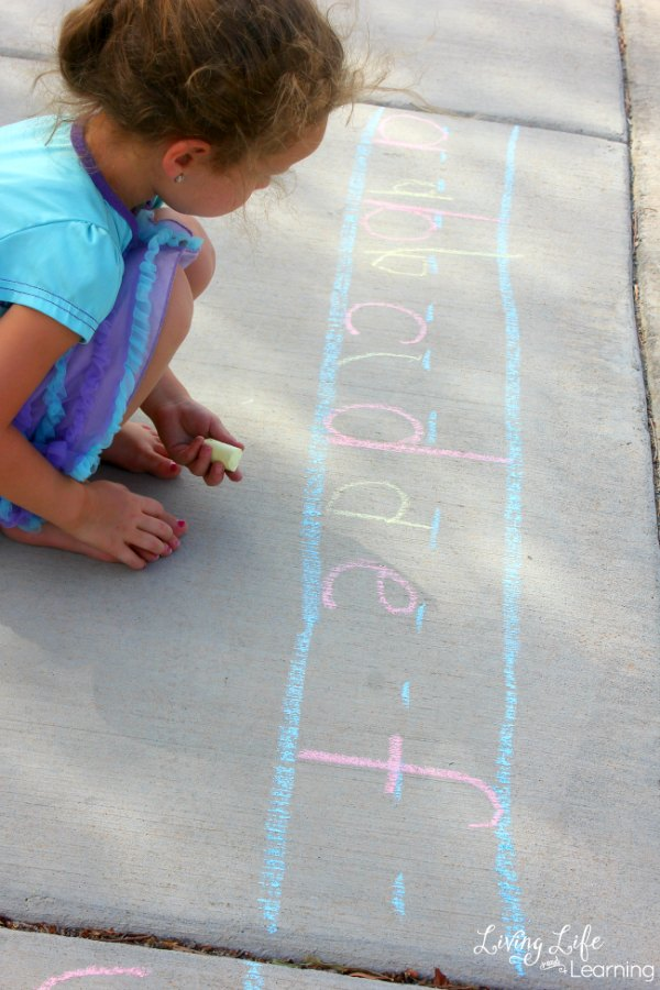 In this post, we will share with you some awesome early writing ideas using sidewalk chalk! My daughter enjoyed not only reviewing her alphabet letter names and sounds, but she also loved practicing writing the letters.