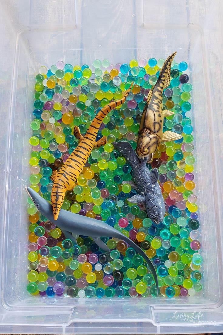Fun prehistoric sea creatures sensory bin