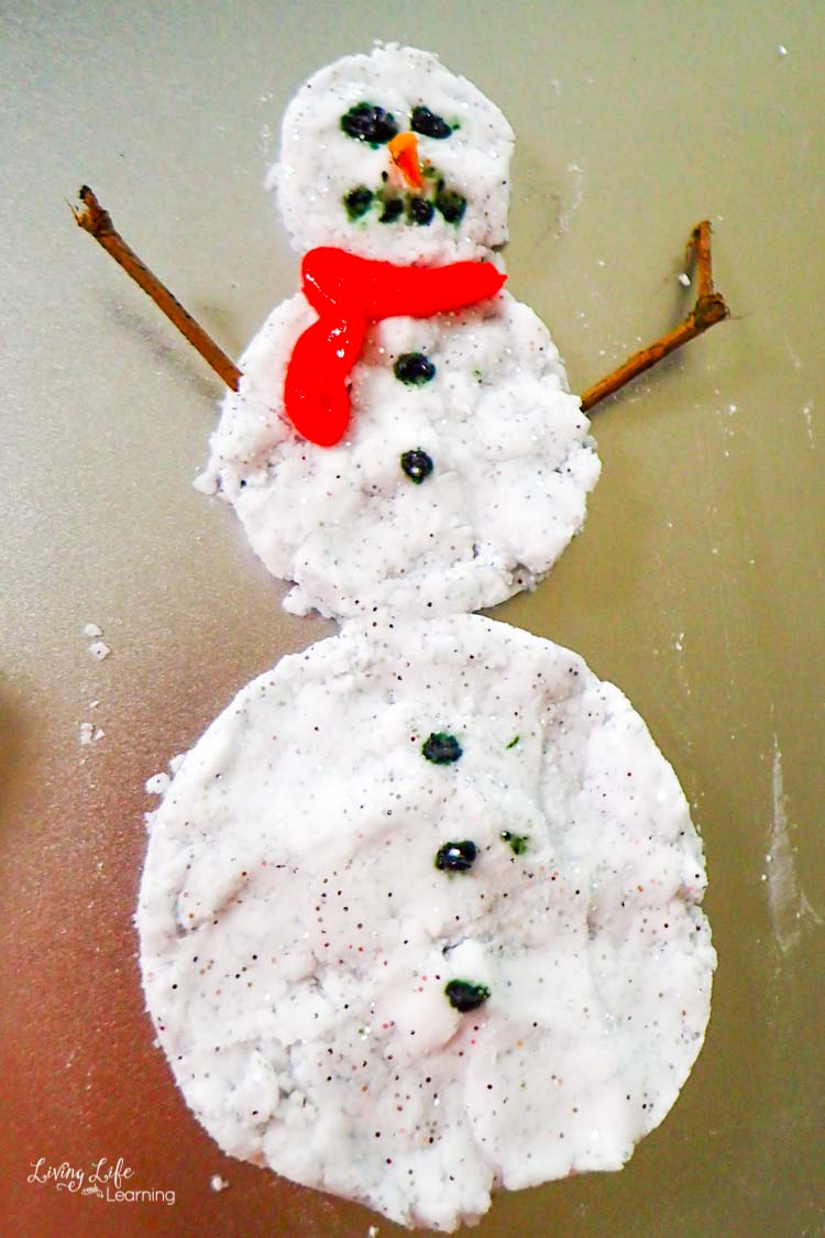 Fizzy Snowman Science on a baking sheet