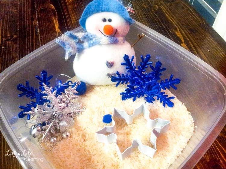 Simple snowman sensory bin with white rice