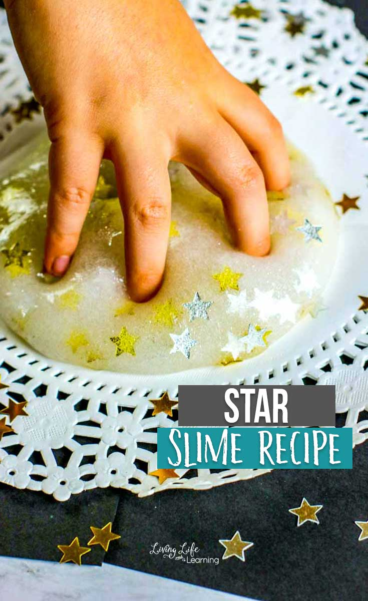 Magical star slime with a small child's hand just beginning to explore.