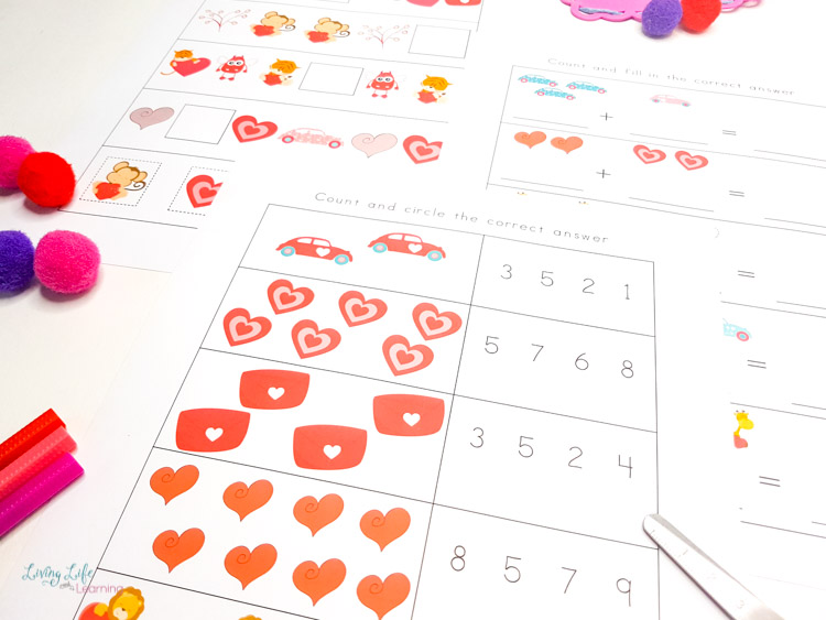 Valentines kindergarten math worksheets with addition and subtraction problems.