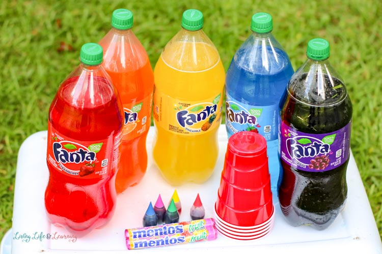 We used Fanta and Mentos for this rainbow pop and mint candy science experiment.