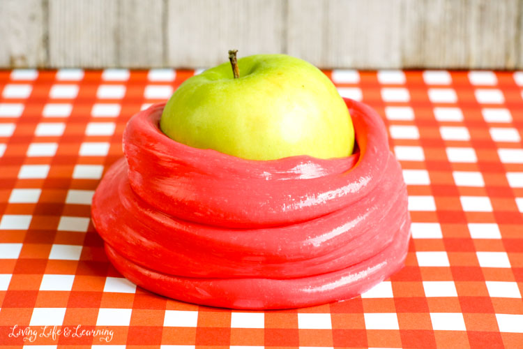Green apple wrapped in red apple-scented slime for decoration