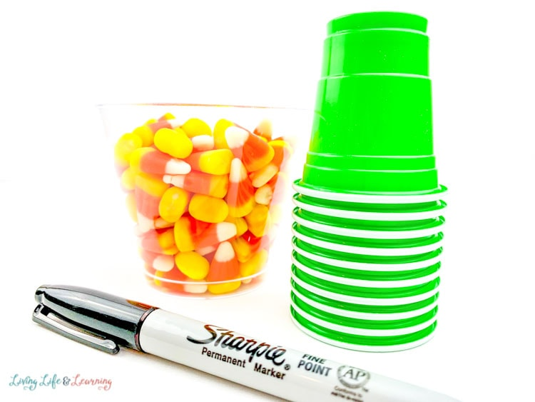 We used bright green plastic cups, a permanent marker and candy corn to teach counting.