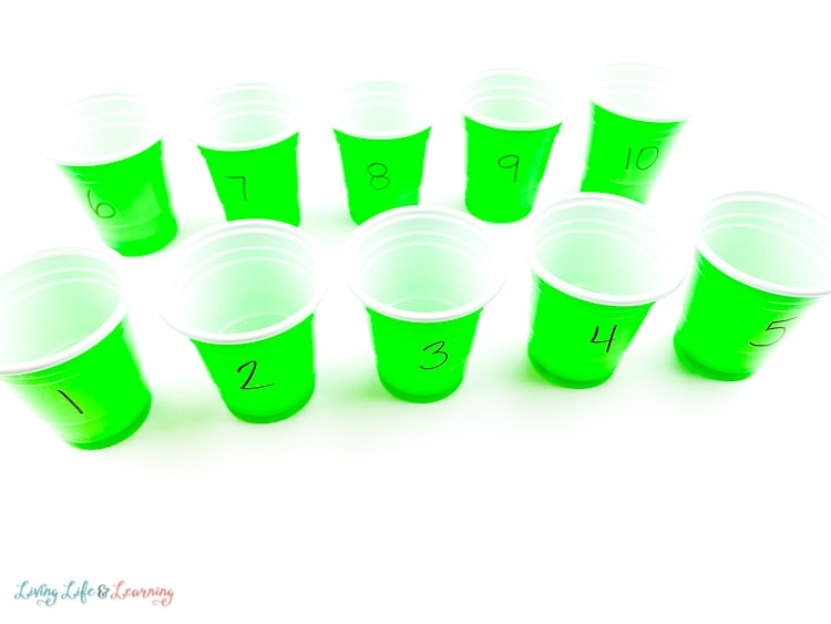 Label the green plastic cups with numbers from 1-10