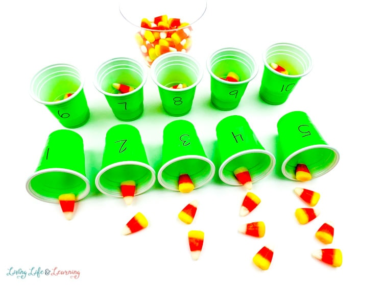 Line up the candy corn next to each cup to show how much there is and to compare.
