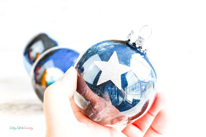 Decorating these DIY galaxy ornaments your kids will love