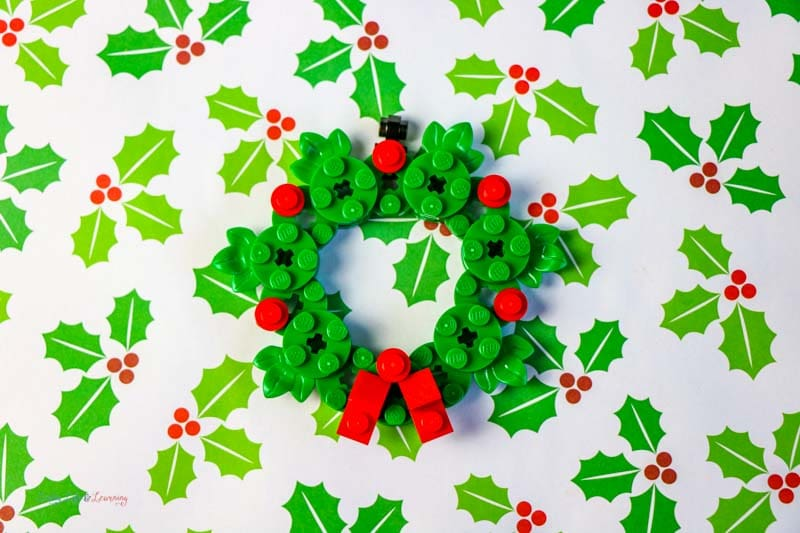Making Lego ornaments has become increasingly popular. And this DIY Lego wreath ornament is not only super simple to make, but adorable too.