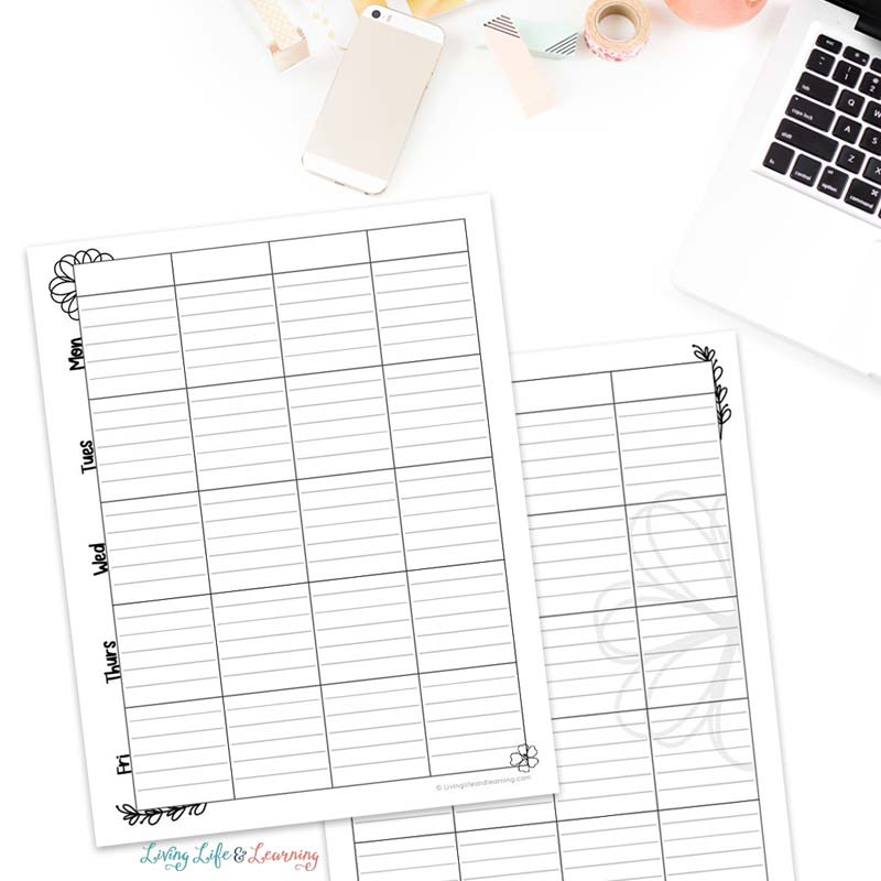 lesson planning pages on a desktop near a laptop